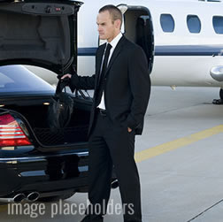 chauffeur pulling out luggage out of the trunk